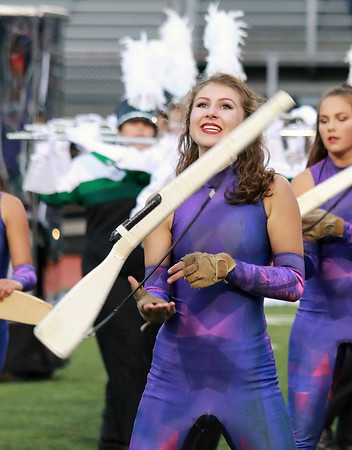 Stacey Diamond | The Goshen News<br /> Junior color guard member Erin Greising puts a warm smile on during a brisk performance at ISSMA Semi-State for the Concord Marching Minutemen.