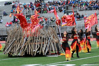 "Stacey Diamond | The Goshen News Members of Goshen's color guard perform their show ""Pyromania"" at Ben Davis High School Saturday, part of ISSMA Semi-State Class A competition."
