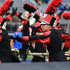 Stacey Diamond | The Goshen News<br /> Emmanuel Gomez, Carlos Vivero and Kevin Silva performe hand gestures in formation with their tenor saxophones for the Goshen Crimson Marching Band.
