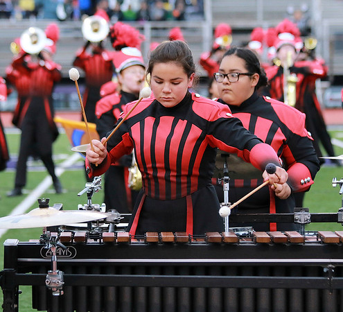 Stacey Diamond | The Goshen News Eve MIller plays the marimba with the Goshen Crimson Marching during Semi-State competition Saturday.