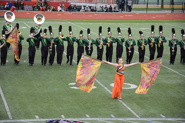 Julie Maas | The Goshen News Emily Hamilton, color guard, leads the Northridge Raiders as they march toward the stands at Pike High School Saturday.