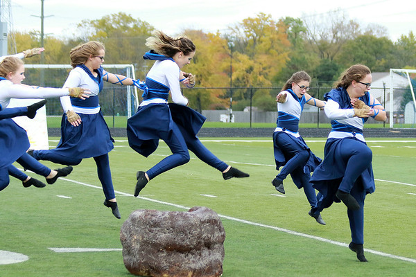 Stacey Diamond | The Goshen News<br /> Members of Fairfield's color guard leap to new heights during Saturday's ISSMA Semi-State competition.