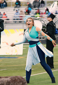 Stacey Diamond | The Goshen News Maria Nisley sells her sword twirling act to the fans and judges at ISSMA Semi-State.
