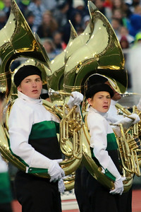 Stacey Diamond | The Goshen News Cameron Crussemeyer, a junior, and Malachi Stahlhandske, a freshman, strike a pose during the Concord Marching Minutemen's performance at ISSMA Semi-State at Ben Davis High School Saturday.