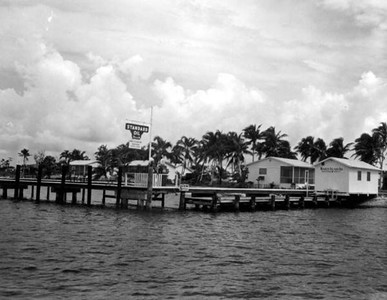 A view of the Standard Oil Company sign at dock taken during a boat trip in July 1961. State Archives of Florida
