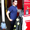 Saugus, Ma. 5-8-17. Saugus firefighter Marco Tirella after returning from a run on the ladder truck.