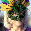 Times photo/Robert Ruiz. 2/17/01.<br /> Yvonne Leone of Bossier City enjoys the day at the Krewe of Centaur parade in her Mardi Gras mask.