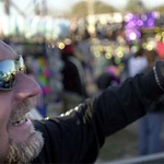 Photo by Mike Silva - The Krewe of Centaur is reflected in the glasses of someone trying to catch beads.