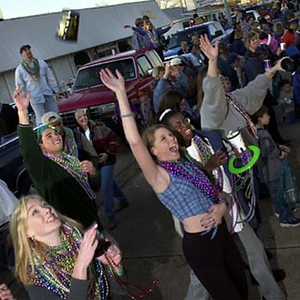 Photo by Mike Silva - Bossier City residents wait to catch beads in the Krewe of Centaur parade.