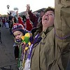 Photo by Mike Silva - scanned 02/17/01 - Keith Beckmann, 7 months,  doesn't seem as excited as his mother Joneva  about catching beads at the Krewe of Centaur parade.