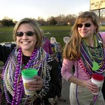 Photo by Mike Silva - Two persons wait for the next float in The Krewe of Centaur parade in Bossier City.