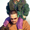 Times photo/Robert Ruiz. 2/17/01.<br /> Glenn Long holds his daughter Emily on his shoulders during the Krewe of Centaur parade Saturday. The Longs aare from Doyline.