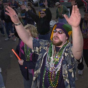 Photo by Mike Silva - Nick Singhoff waits to catch beads in the Krewe of Centaur Parade as it winds through Bossier City.