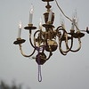 Mardi Gras Parade in Shreveport La.   Old chandelier hanging from lamp post outside