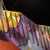Beads hanging on Mardi Gras Float