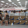 people shopping for air conditioners.