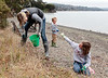 Eimile Bouas of Mill Valley picks up small bits of styrofoam and plastic at the high water line with the help of her two children, Dimitri,4, and Athena, 8, on Coastal Cleanup Day at the Richardson Bay Audubon Center in Tiburon, Calif. on Saturday, September 15, 2012.(Special to the IJ/Jocelyn Knight)