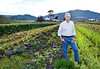Robert Berner, Executive Director of Marin Agricultural Land Trust, in the rows of organic vegetables grown by David Retsky of CountyLine Harvest, who leases land on the Dolcini Ranch in West Marin on Thursday, February 9, 2012.Berner is retiring from his position at MALT after 27 years of service.(Special to the IJ/Jocelyn Knight)