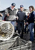 Kevin Lunny, center, owner of Drakes Bay Oyster Company, shows the sorting machine that the oysters tumble through to Interior Secretary Ken Salazar, left, on Drakes Estero in the Point Reyes National Seashore, Calif. on Wednesday, November 21, 2012.(Special to the IJ/Jocelyn Knight)