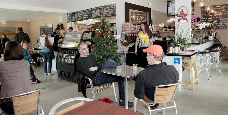 Ari Blum, center, of Larkspur, chats with his father Joe Blum, right, of Tiburon, while they wait for their order at Cafe Verde in Corte Madera near Corte Madera Town Park , on Friday, December 28, 2012.(Special to the IJ/Jocelyn Knight)