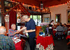 Long time waiter Giovanni Pardidi greets customer Penn Arnet at Fradelizio, an italian restaurant in Fairfax, Calif. on Thursday, August 18, 2011.(Special to the IJ/Jocelyn Knight)