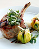 """An oak grilled pork chop, atop melted walla walla onions, with saba """"candy striped"""" glazed figs, purslane, and pepato at Murray Circle restaurant in Cavallo Point, Sausalito, Calif.  on Thursday, September 1, 2011.(Special to the IJ/Jocelyn Knight)"""