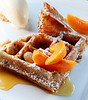 A quinoa waffle with roasted apricot, marcona almonds and rose geranium ice cream is a gluten-free dessert at Murray Circle restaurant at Cavallo Point in Sausalito, Calif. (Special to the IJ/Jocelyn Knight)