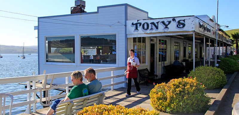 Jessica Quattlander of Point Reyes, center, has been serving folks for 9 years at Tony's Seafood restaurant, established in 1948  on Tomales Bay in Marshall, Calif. on Friday, April 20, 2012.The restaurant is  open Friday, Saturday and Sunday, 12:00 -8:00PM. (Special to the IJ/Jocelyn Knight)