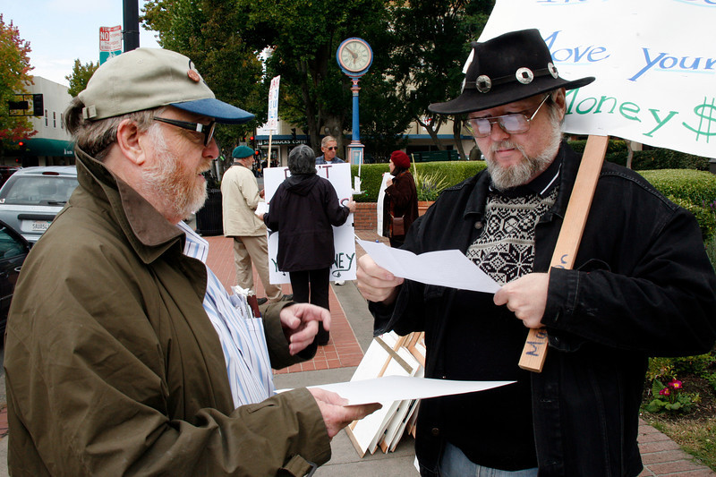 Martin Schaaf, left, as part of the bumper sticker working group gets imput from Marcus Mulkins at the Bank Transfer Day protest in downtown San Rafael, Calif. on Saturday November 5, 2011. (Special to the IJ/ James Cacciatore)