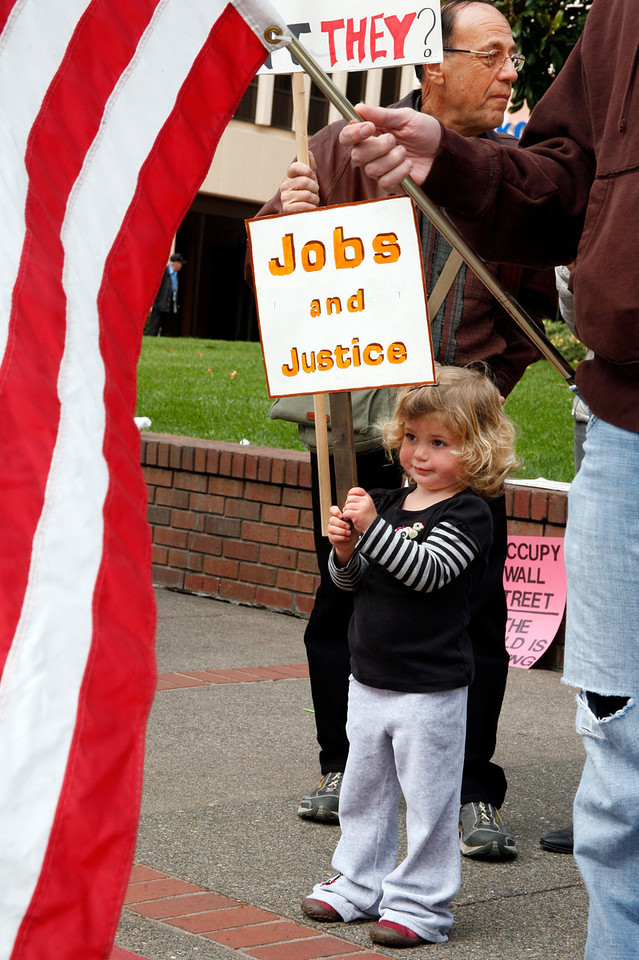 Two and three quarter year old Mikayla Gounard join her mother and grandfather during the Bank Transfer Day protest in downtown San Rafael, Calif. on Saturday November 5, 2011. (Special to the IJ/ James Cacciatore)