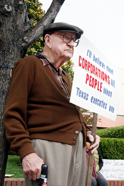 87 year old Ralph Sherlock of Novato protests in front of Bank of America during the Bank Transfer Day protest in downtown San Rafael, Calif. on Saturday November 5, 2011. (Special to the IJ/ James Cacciatore)