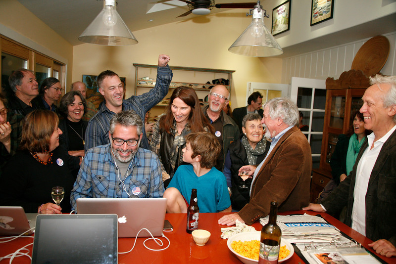 Larry Bragman, right,  with happy supporters gather at his house on election night in Fairfax, Calif. on Tuesday November 8, 2011. The group celebrated his re-election and Ryan O'Neil's, center with arm raised, election to town council and measure D's passage. (Special to the IJ/ James Cacciatore)