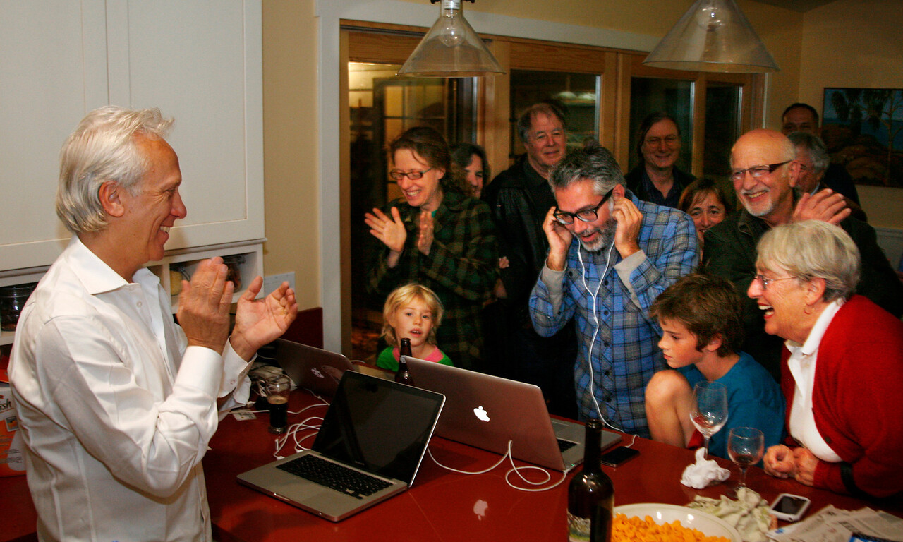 Larry Bragman, left,  with happy supporters gather at his house on election night in Fairfax, Calif. on Tuesday November 8, 2011. The group celebrated his re-election and Ryan O'Neil's election to town council and measure D's passage. (Special to the IJ/ James Cacciatore)