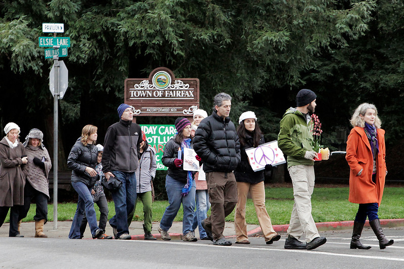 Roni Krouzman, second from right, organized the gathering that held vigil and silently walked through the town of Fairfax, Calif. Saturday, December 15, 2012. People from all over Marin came together at town park in Fairfax for a vigil to mourn the tragedy in Connecticut. (Special to the IJ/James Cacciatore)