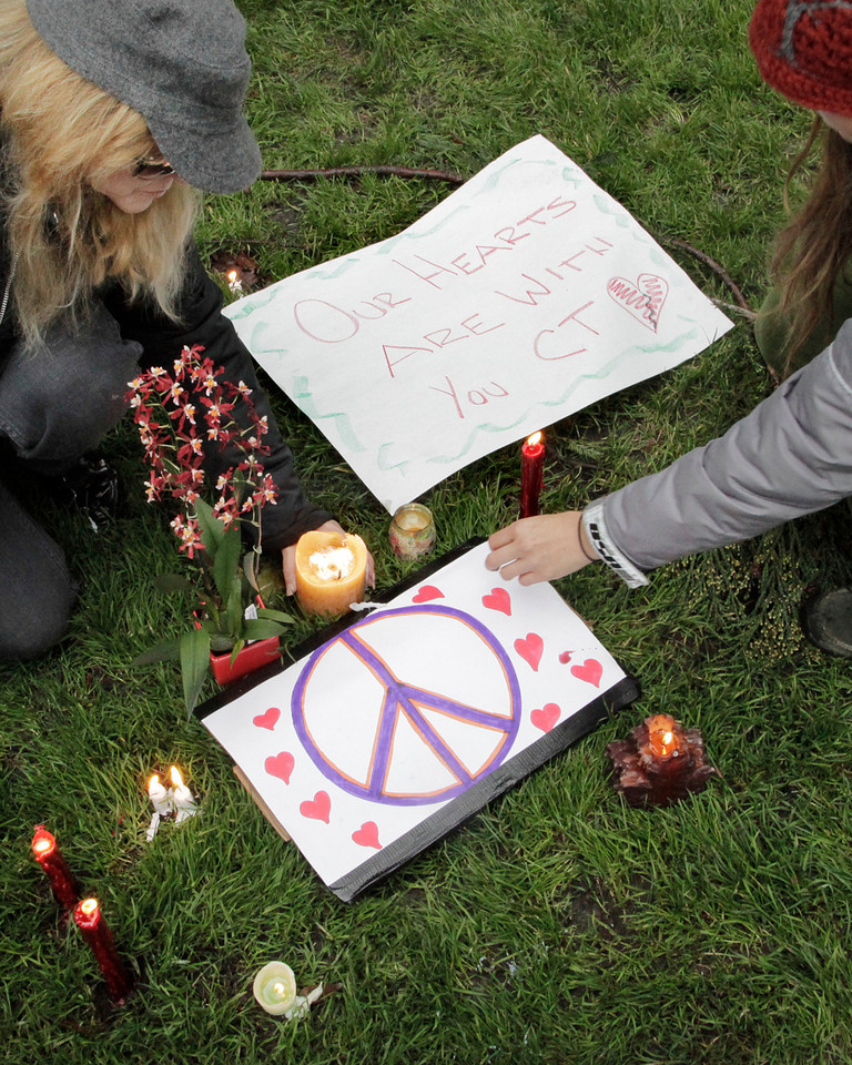 Candles and home made signs were brought by people from all over Marin as they came together for a vigil to mourn the tragedy in Connecticut at town park in Fairfax, Calif. Saturday, December 15, 2012. (Special to the IJ/James Cacciatore)