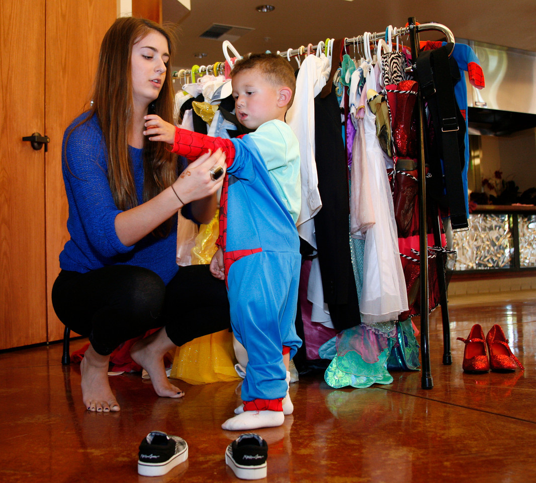 Haley Buckles, left, helps two year old Tristan Lopez into a Spiderman costume for his portrait by The Family Album Project at Homeward Bound in Novato, Calif. on Sunday, June 10, 2012. (Special to the IJ/ James Cacciatore)
