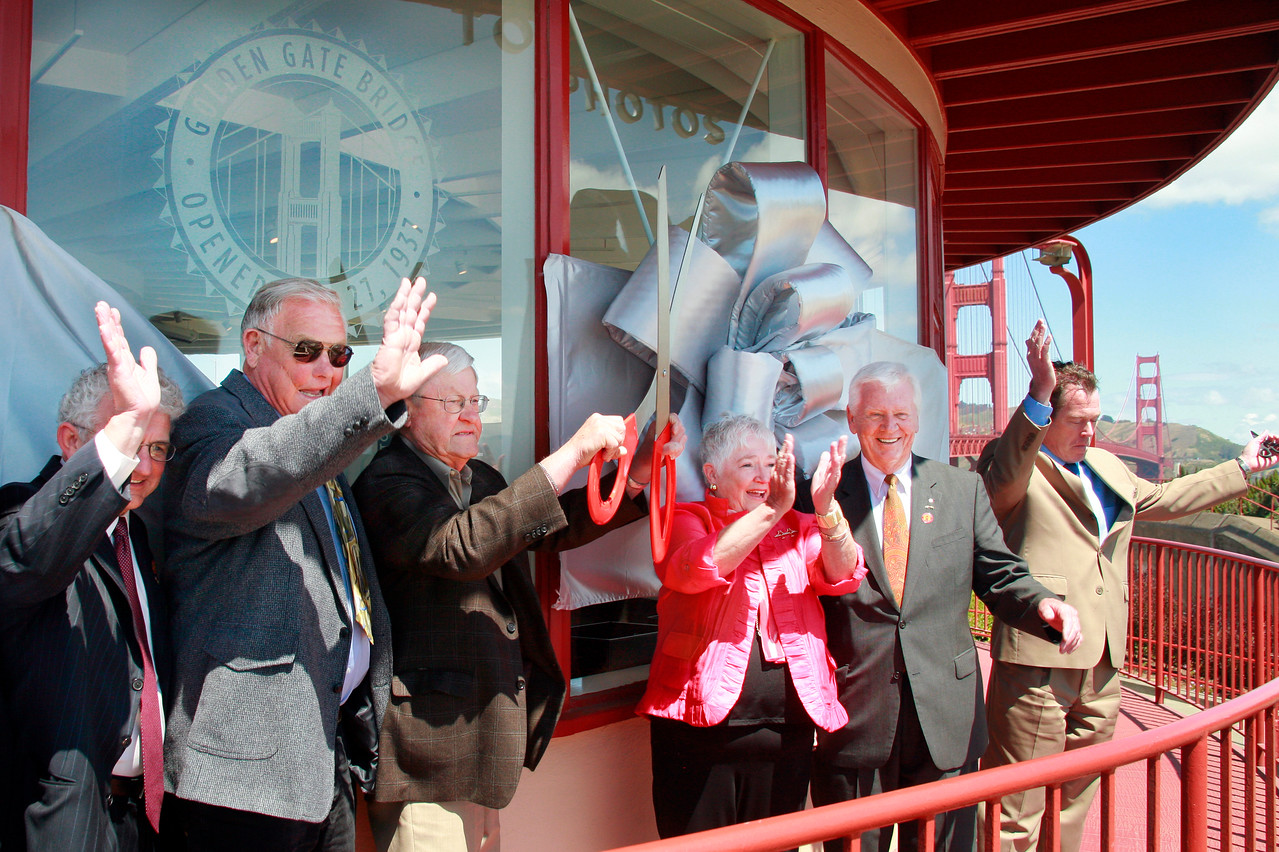 Dignitaries wave to the crowd after cutting the ribbon to officially reopen the Golden Gate Bridge Round House, from right are Dick Grosboll, James Eddie, Dietrich Stroeh, Barbara Pahre, Jerry Cochran and GG Bridge General Manager Denis J. Mulligan at the Golden Gate Bridge Plaza in San Francisco, Calif. on Friday, May 25, 2012. (Special to the IJ/ James Cacciatore)