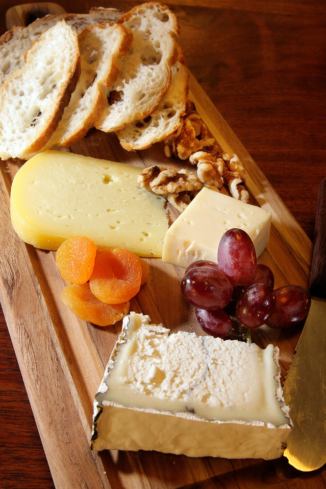 Local cheese plate with Nicasio Farms Square, Carmondy of Bellwether, and Humbolt Fog served with grapes, dried apricots, walnuts and artisanal bread at La Loggia in San Anselmo, Calif. Thursday, November 1, 2012.(Special to the IJ/James Cacciatore)