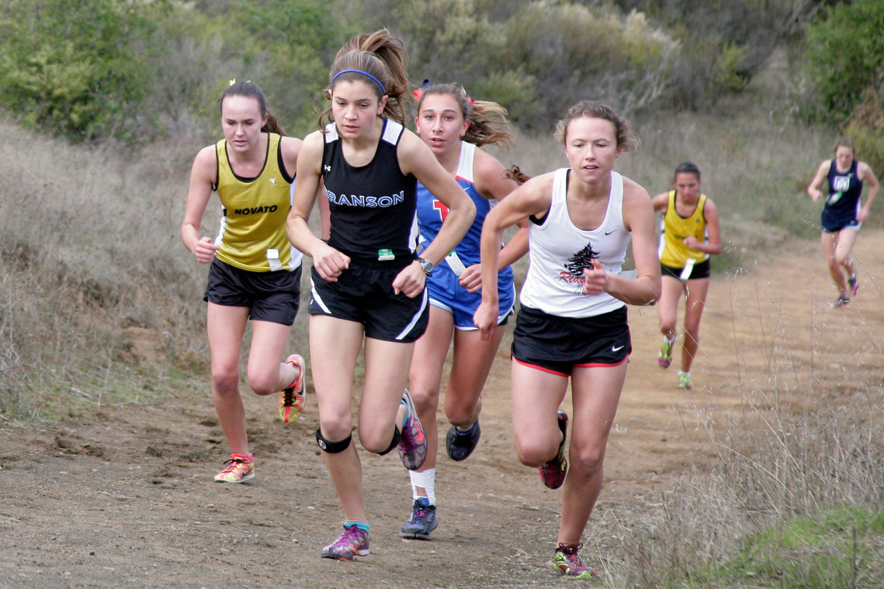 Anna Harleen, second from left, of Branson and Megan Bordes, forth from left, of Redwood and Bella Amyx, third from left, of Tam climb the first hill and will ultimately finish second, third and fourth, respectively in the girls MCAL cross country championship in Novato, Calif. Thursday, November 8, 2012.(Special to the IJ/James Cacciatore)