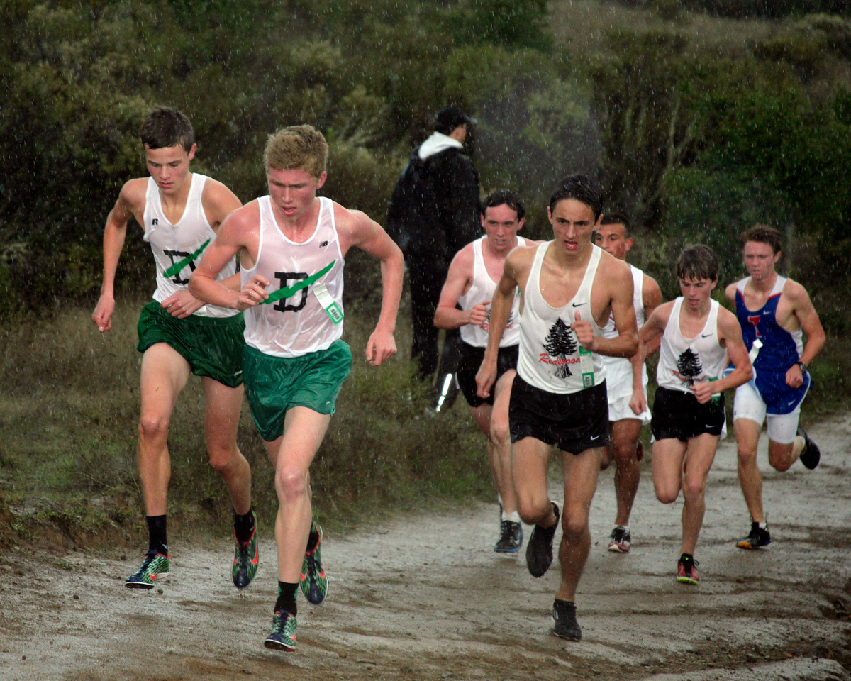 Clayton Hutchins, from left, and John Lawson both from Drake high school lead the field as the rain begins to fall during the boys MCAL cross country championship in Novato, Calif. Thursday, November 8, 2012.(Special to the IJ/James Cacciatore)