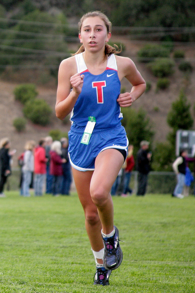 Bella Amyx of Tam comes in fourth in the girls MCAL cross country championship in Novato, Calif. Thursday, November 8, 2012.(Special to the IJ/James Cacciatore)
