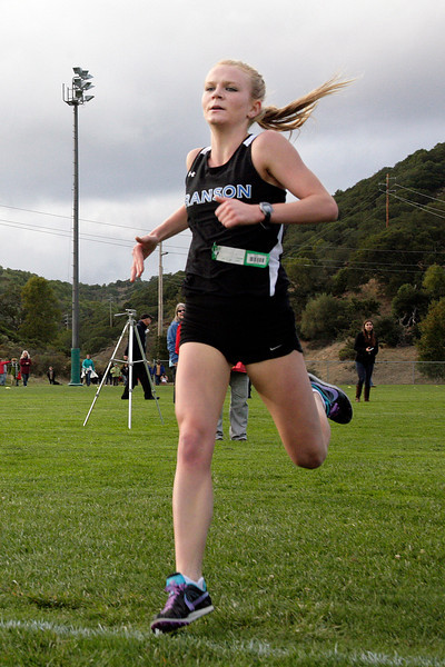 Julia Maxwell of Branson high school crosses the finish line first during the girls MCAL cross country championship in Novato, Calif. Thursday, November 8, 2012.(Special to the IJ/James Cacciatore)