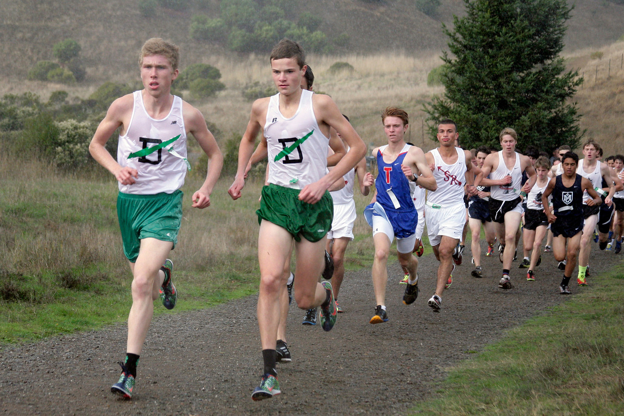 John Lawson, from left, and Clayton Hutchins both from Drake high school lead the field as the rain begins to fall during the boys MCAL cross country championship in Novato, Calif. Thursday, November 8, 2012.(Special to the IJ/James Cacciatore)