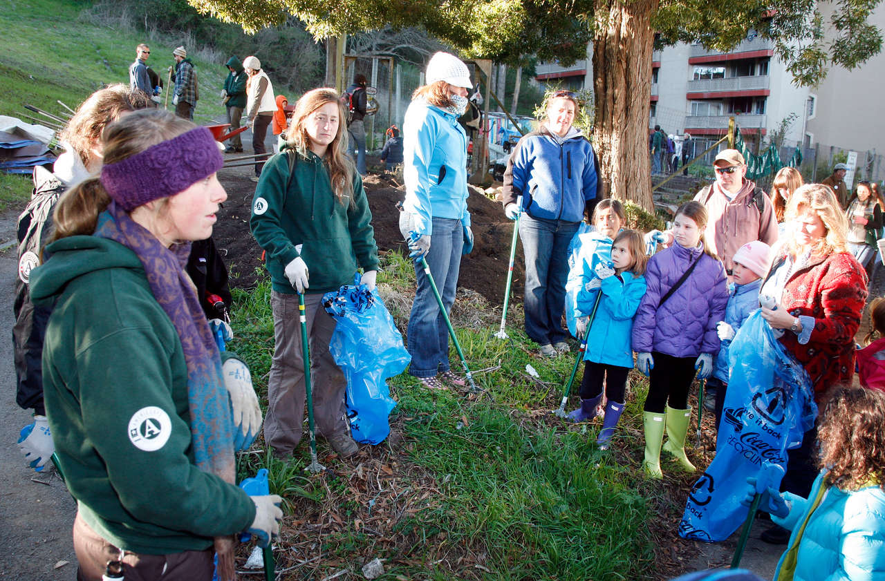 Participants of a Martin Luther King Day work crew assemble for trash pick up instructions at the community garden on Cole Drive in Marin City, Calif. on Monday, January 16, 2012.  (Special to the IJ/James Cacciatore Photo)