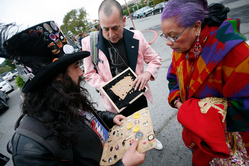 Before the concert Lucrecia Fontes,right, of San Francisco, looks at pins held by Finch, left, and Pan, center, in the parking lot of the Marin Center. Bob Weir and the Marin Symphony performed music of the Grateful Dead at the Marin Veterans Memorial Auditorium in San Rafael, Calif. on Saturday, May 7, 2011. (Special to the IJ/ James Cacciatore)