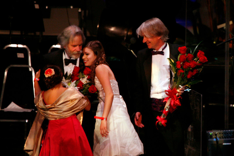 Bob Weir and Giancarlo Aquilanti receive celebratory bouquets at the conclusion of the Marin Symphony performance featuring the music of the Grateful Dead at the Marin Veterans Memorial Auditorium in San Rafael, Calif. on Saturday, May 7, 2011. (Special to the IJ/ James Cacciatore)