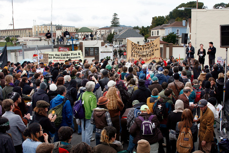 A crowd of Occupy protesters listen to speeches from the three freed Iran Hikers, Sarah Shourd, center on stage at right, Shane Bauer, left, and Josh Fattal at the main gate to San Quentin Prison in San Quentin, Calif. on Monday, February 20, 2012.  (Special to the IJ/James Cacciatore)