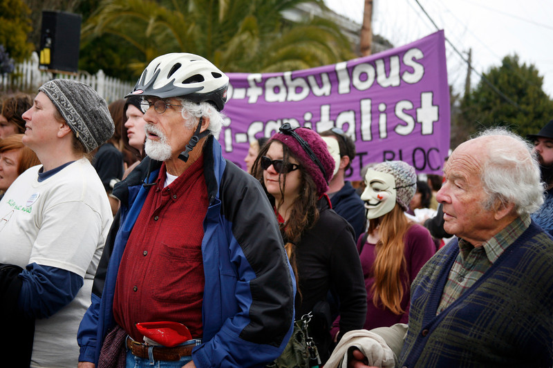 Marinites Dede Teeler, left, Steve Bingham, in helmet, and Alen Barnett, far right, listen to protest speeches along with Occupy protesters from San Francisco and Oakland at the main gate to San Quentin Prison in San Quentin, Calif. on Monday, February 20, 2012.  (Special to the IJ/James Cacciatore)