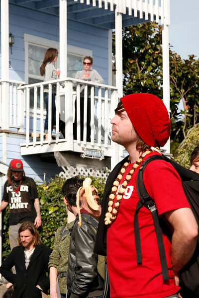 Kyle Leslie, in red hat, of San Francisco enjoys a banana while from their balcony Emily Chourre, left, and Katie Wheeler enjoy a guaza-mosa at the main gate to San Quentin Prison in San Quentin, Calif. on Monday, February 20, 2012.  (Special to the IJ/James Cacciatore)