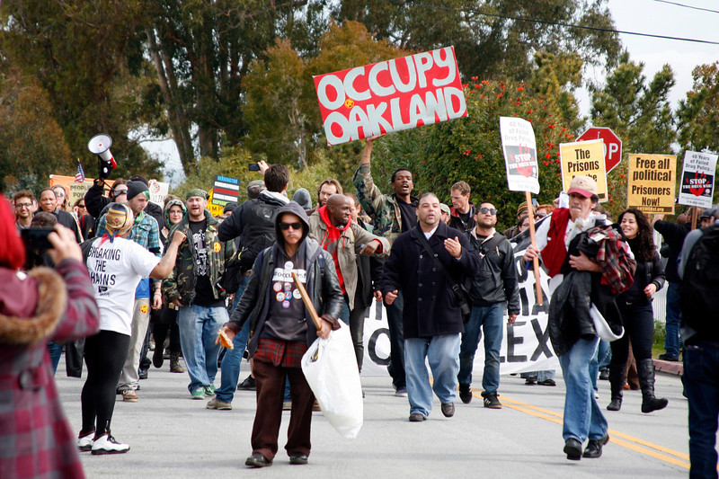 A crowd of Occupy protesters march to the main gate of San Quentin Prison to listen to speeches in support of prisoners rights in San Quentin, Calif. on Monday, February 20, 2012.  (Special to the IJ/James Cacciatore)